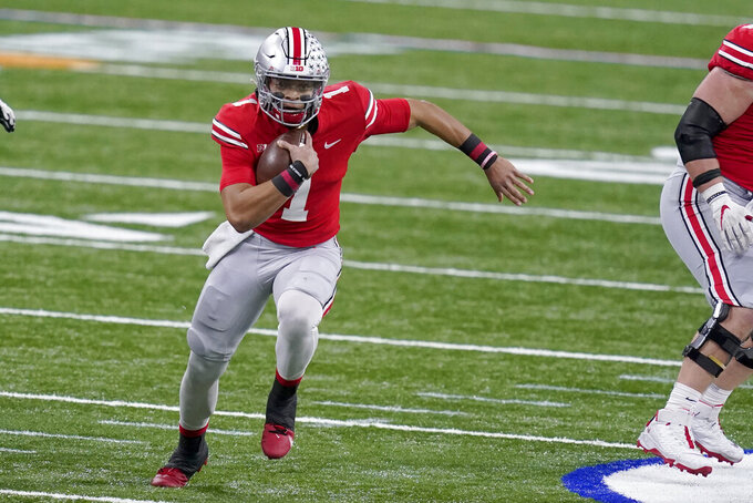 Ohio State quarterback Justin Fields runs with the ball during the first half of the Big Ten championship NCAA college football game against Northwestern, Saturday, Dec. 19, 2020, in Indianapolis. (AP Photo/Darron Cummings)