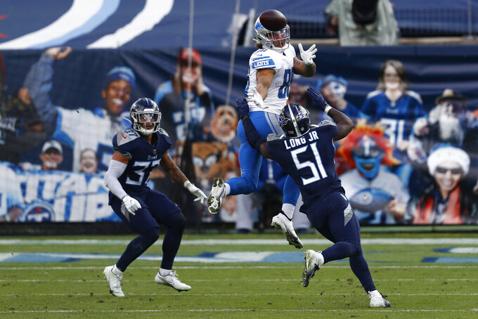 Detroit Lions tight end Hunter Bryant catches a pass over Tennessee Titans linebacker David Long during the second half of an NFL football game Sunday, Dec. 20, 2020, in Nashville, Tenn. (AP Photo/Wade Payne)