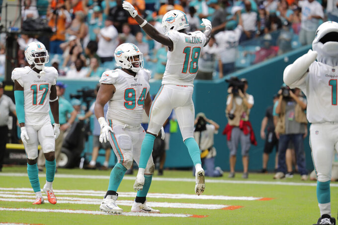 Miami Dolphins wide receiver Preston Williams (18) celebrates with Miami Dolphins defensive tackle Christian Wilkins (94) after scoring a touchdown during the first half of an NFL football game against the New York Jets, Sunday, Nov. 3, 2019, in Miami Gardens, Fla. (AP Photo/Lynne Sladky)