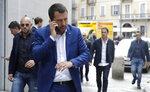 Italian Interior Minister and Deputy-Premier, Matteo Salvini, talks on the phone as he arrives for a press conference at the foreign press association in Milan, Italy, Friday, May 17, 2019. (AP Photo/Luca Bruno)