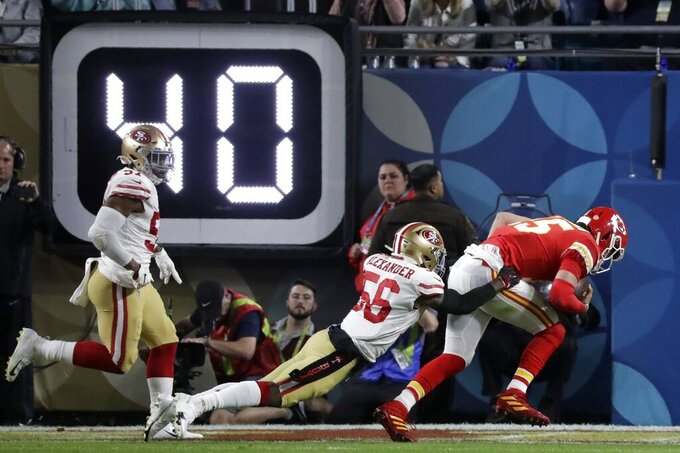 Kansas City Chiefs quarterback Patrick Mahomes (15) scores past San Francisco 49ers' Kwon Alexander (56) during the first half of the NFL Super Bowl 54 football game Sunday, Feb. 2, 2020, in Miami Gardens, Fla. (AP Photo/Wilfredo Lee)