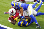 Arizona Cardinals running back Jonathan Ward, middle, scores a touchdown between Los Angeles Rams outside linebacker Kenny Young, top, and free safety John Johnson III during the first half of an NFL football game in Inglewood, Calif., Sunday, Jan. 3, 2021. (AP Photo/Jae C. Hong)