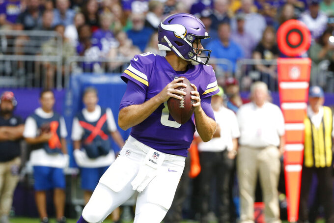 Minnesota Vikings quarterback Kirk Cousins looks to throw a pass during the first half of an NFL preseason football game against the Arizona Cardinals, Saturday, Aug. 24, 2019, in Minneapolis. (AP Photo/Bruce Kluckhohn)