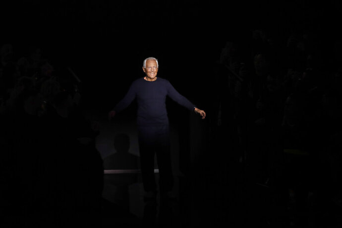 Designer Giorgio Armani accepts applause at the conclusion of the Emporio Armani men's Fall-Winter 2020/21 collection, that was presented in Milan, Italy, Saturday, Jan. 11, 2019. (AP Photo/Luca Bruno)