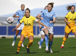 Tottenham Hotspur's Josie Green, left, and Manchester City's Sam Mewis vie for the ball,  in the Women's Super League soccer match between Manchester City and Tottenham Hotspur, at the Academy Stadium, Manchester, England,  Sunday Oct. 4, 2020. (AP Photo/Dave Thompson)