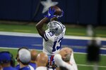 Dallas Cowboys wide receiver Michael Gallup (13) makes a catch along the sideline as the New York Giants bench looks on in the second half of an NFL football game in Arlington, Texas, Sunday, Oct. 11, 2020. (AP Photo/Michael Ainsworth)