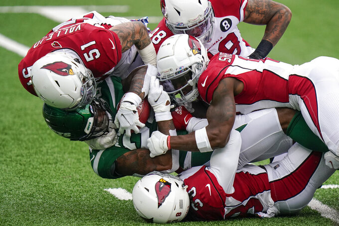 New York Jets running back La'Mical Perine, lower left, is tackled by Arizona Cardinals linebacker Tanner Vallejo (51) during the first half of an NFL football game, Sunday, Oct. 11, 2020, in East Rutherford. (AP Photo/Frank Franklin II)