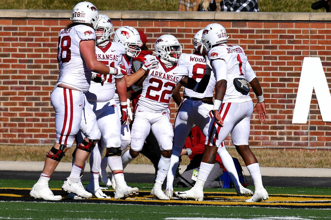Arkansas running back Trelon Smith (22) is congratulated by teammates after scoring during the first half of an NCAA college football game against Missouri Saturday, Dec. 5, 2020, in Columbia, Mo. (AP Photo/L.G. Patterson)