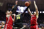 Purdue forward Trevion Williams (50) grabs a rebound between Wisconsin forward Micah Potter (11) and guard Brevin Pritzl (1) during the second half of an NCAA college basketball game in West Lafayette, Ind., Friday, Jan. 24, 2020. (AP Photo/Michael Conroy)