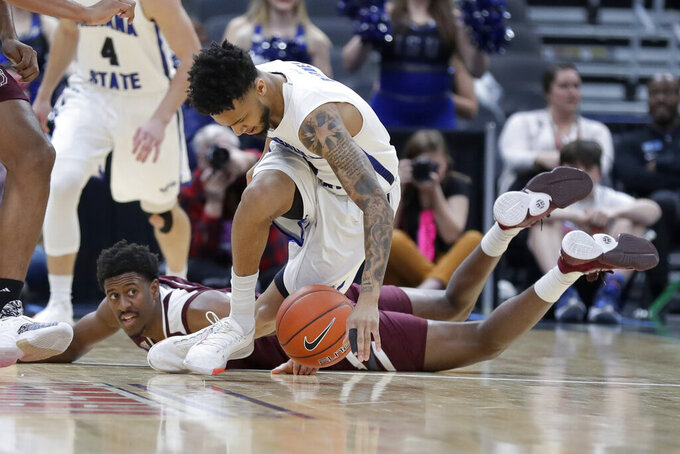 Indiana State's Jordan Barnes, front, dives after a loose ball as Missouri State's Keandre Cook, rear, watches during the first half of an NCAA college basketball game in the quarterfinal round of the Missouri Valley Conference men's tournament Friday, March 6, 2020, in St. Louis. (AP Photo/Jeff Roberson)