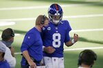 New York Giants offensive coordinator Jason Garrett, left, talks with quarterback Daniel Jones (8) on the sideline late in the second half of an NFL football game against the Dallas Cowboys in Arlington, Texas, Sunday, Oct. 11, 2020. (AP Photo/Michael Ainsworth)