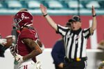 Alabama wide receiver DeVonta Smith scores a touchdown against Ohio State during the first half of an NCAA College Football Playoff national championship game, Monday, Jan. 11, 2021, in Miami Gardens, Fla. (AP Photo/Chris O'Meara)