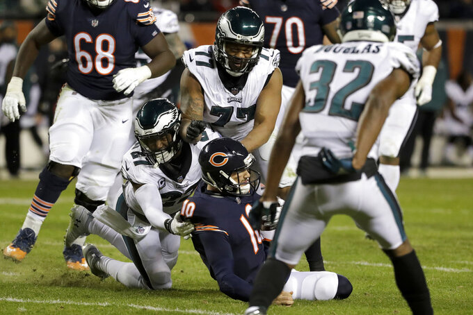 Chicago Bears quarterback Mitchell Trubisky (10) is tackled by Philadelphia Eagles strong safety Malcolm Jenkins (27) and defensive end Michael Bennett (77) during the second half of an NFL wild-card playoff football game Sunday, Jan. 6, 2019, in Chicago. (AP Photo/Nam Y. Huh)