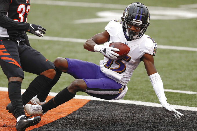 Baltimore Ravens wide receiver Marquise Brown (15) tumbles into the end zone after making a catch for a touchdown during the first half of an NFL football game against the Cincinnati Bengals, Sunday, Jan. 3, 2021, in Cincinnati. (AP Photo/Aaron Doster)