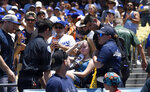 A young fan is carted away after being hit with a foul ball hit by Los Angeles Dodgers' Cody Bellinger during the first inning of a baseball game against the Colorado Rockies, Sunday, June 23, 2019, in Los Angeles. (AP Photo/Mark J. Terrill)