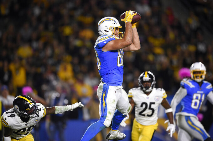Los Angeles Chargers tight end Hunter Henry, second from left, catches a pass for a touchdown as Pittsburgh Steelers defensive back Kam Kelly, left, and cornerback Artie Burns, second from right, watches along with wide receiver Mike Williams during the second half of an NFL football game, Sunday, Oct. 13, 2019, in Carson, Calif. (AP Photo/Kelvin Kuo)