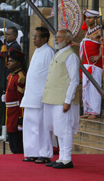 Indian Prime Minister Narendra Modi, right, stands with Sri Lankan President Maithripala Sirisena, as he receives a guard of honor upon his arrival at the presidential secretariat in Colombo, Sri Lanka, Sunday, June 9, 2019. Modi arrived in Sri Lanka on Sunday for a brief visit as part of his first overseas tour since reelection that emphasizes India's