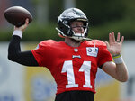 Philadelphia Eagles quarterback Carson Wentz throws the football during an NFL football training camp practice in Philadelphia, Monday, Aug. 24, 2020. (Yong Kim/Pool Photo via AP)