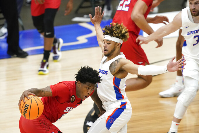 SMU guard Kendric Davis, left, drives past Boise State guard Marcus Shaver Jr., right, during the first half of an NCAA college basketball game in the first round of the NIT, Thursday, March 18, 2021, in Frisco, Texas. (AP Photo/Tony Gutierrez)