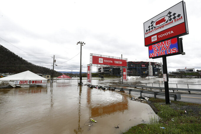 Water floods the vendor area as races for both the Truck Series and NASCAR Cup Series auto race were postponed due to inclement weather at Bristol Motor Speedway, Sunday, March 28, 2021, in Bristol, Tenn. (AP Photo/Wade Payne)