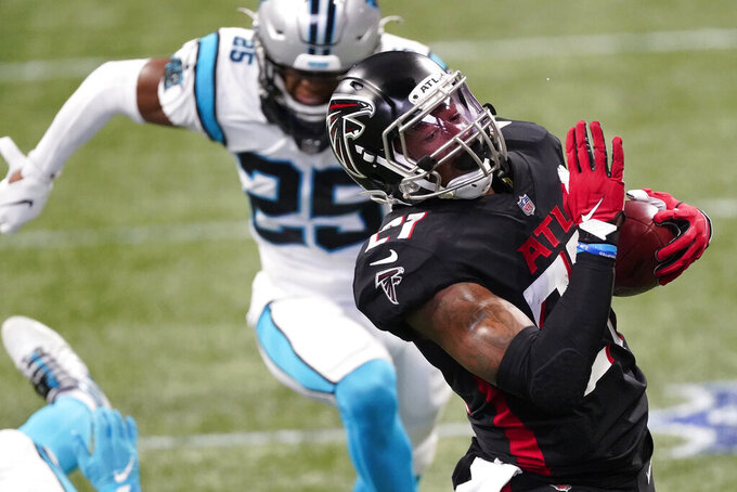 Atlanta Falcons running back Todd Gurley (21) runs against the Carolina Panthers during the first half of an NFL football game, Sunday, Oct. 11, 2020, in Atlanta. (AP Photo/John Bazemore)