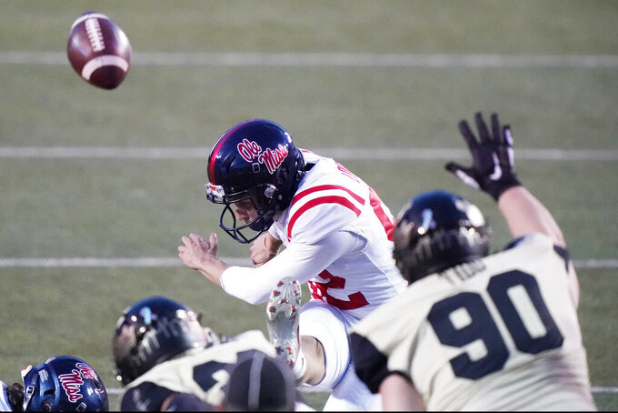 Mississippi place kicker Luke Logan (92) kicks an extra point over the reach of Vanderbilt's Cameron Tidd (90) in the second half of an NCAA college football game Saturday, Oct. 31, 2020, in Nashville, Tenn. Mississippi won 54-21. (AP Photo/Mark Humphrey)
