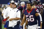 Houston Texans head coach David Culley left, and linebacker Hardy Nickerson (56) watch play in the first half of a preseason NFL football game against the Dallas Cowboys in Arlington, Texas, Saturday, Aug. 21, 2021. (AP Photo/Michael Ainsworth)