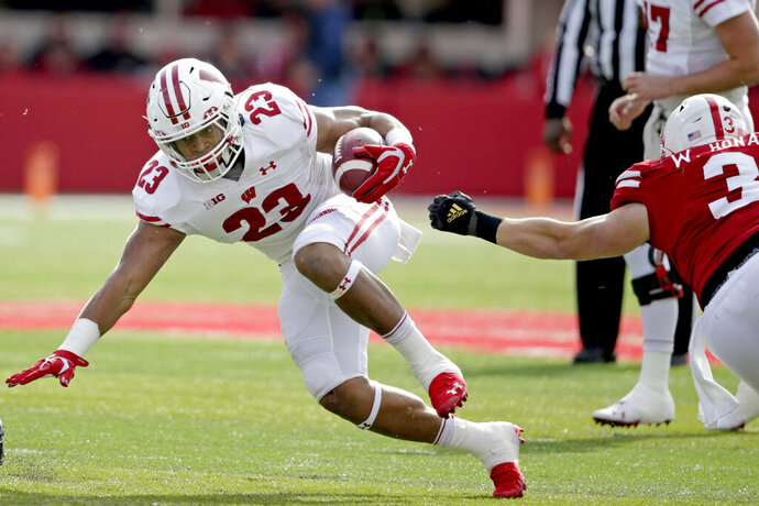 Wisconsin running back Jonathan Taylor (23) runs with the ball away from Nebraska linebacker Will Honas (3) during the first half of an NCAA college football game in Lincoln, Neb., Saturday, Nov. 16, 2019. (AP Photo/Nati Harnik)