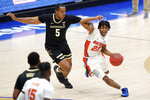 Florida's Tyree Appleby (22) drives against Vanderbilt's D.J. Harvey (5) in the first half of an NCAA college basketball game in the Southeastern Conference Tournament Thursday, March 11, 2021, in Nashville, Tenn. (AP Photo/Mark Humphrey)