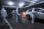 People are tested for the coronavirus by healthcare workers at a drive-through testing site during a nationwide lockdown to curb the spread of the virus, In Modiin, Israel, Monday, Jan. 18, 2021. (AP Photo/Oded Balilty)