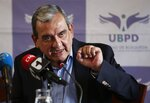 Jaime Alberto Parra, an ex-combatant of the Revolutionary Armed Forces of Colombia, FARC, speaks during a presentation on information on those disappeared during the nation's civil conflict, in Bogota, Colombia, Tuesday, Aug. 20, 2019. A special unit tasked by Colombia's peace process to search for the thousands who disappeared over more than five decades of conflict will analyze the information and work with authorities to try and locate remains. (AP Photo/Fernando Vergara)