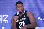 Colorado's Evan Battey speaks during Pac-12 Conference NCAA college basketball media day Wednesday, Oct. 13, 2021, in San Francisco. (AP Photo/Jeff Chiu)