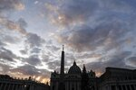 """FILE - In this Thursday, Dec. 5, 2019 file photo, the sun sets over St. Peter's Basilica, at the Vatican. Vatican prosecutors have ordered the seizure of documents and computers from the administrative offices of St. Peter's Basilica in an apparently new investigation into financial irregularities in the Holy See. The Vatican said Tuesday that Pope Francis has also named a special commissioner to run the basilica, reorganize its offices, update its statutes to comply with new Vatican norms on procurement contracts and to """"clarify its administration.""""  (AP Photo/Gregorio Borgia, File)"""