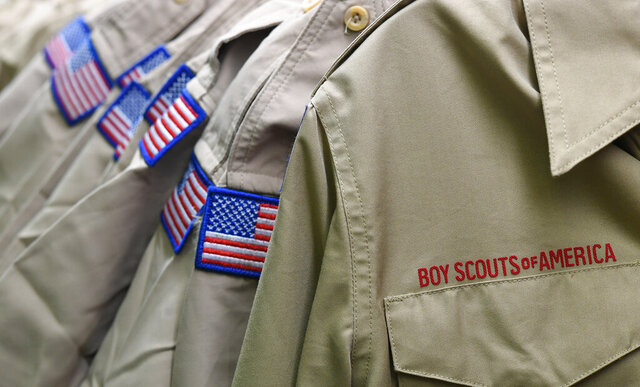 FILE - In this Feb. 18, 2020, file photo, Boy Scouts of America uniforms are displayed in the retail store at the headquarters for the French Creek Council of the Boy Scouts of America in Summit Township, Pa.   Nine sex-abuse lawsuits were filed Tuesday, May 19 2020, in upstate New York against three Boy Scout local councils, signaling an escalation of efforts to pressure councils nationwide to pay a big share of an eventual settlement in the Scouts' bankruptcy proceedings. The lawsuits were filed shortly after an easing of coronavirus lockdown rules enabled courts in some parts of New York to resume the handling of civil cases.  (Christopher Millette/Erie Times-News via AP, File)