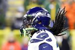 Seattle Seahawks' Marshawn Lynch warms up before an NFL divisional playoff football game against the Green Bay Packers Sunday, Jan. 12, 2020, in Green Bay, Wis. (AP Photo/Darron Cummings)