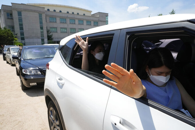Christians inside their car pray during a drive-in worship service amid measures to help prevent the spread of the coronavirus at the Songgok high school in Seoul, South Korea, Sunday, July 25, 2021. (AP Photo/Ahn Young-joon)