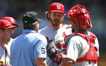 St. Louis Cardinals' pitcher Miles Mikolas, center, gets checked on in the second inning of a baseball game against the Minnesota Twins, Wednesday, May 16, 2018, in Minneapolis. (AP Photo/Jim Mone)