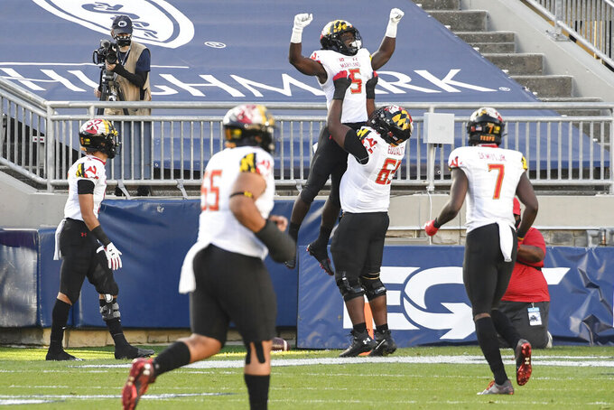 Maryland wide receiver Rakim Jarrett (5) celebrates his first-quarter touchdown pass against Penn State during an NCAA college football game in State College, Pa., Saturday, Nov. 7, 2020. (AP Photo/Barry Reeger)
