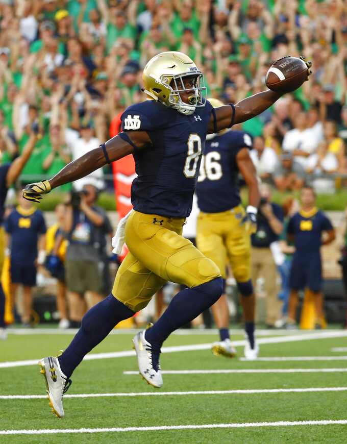 Notre Dame wide receiver Jafar Armstrong (8) celebrates as he scores a touchdown against Michigan in the first half of an NCAA football game in South Bend, Ind., Saturday, Sept. 1, 2018. (AP Photo/Paul Sancya)