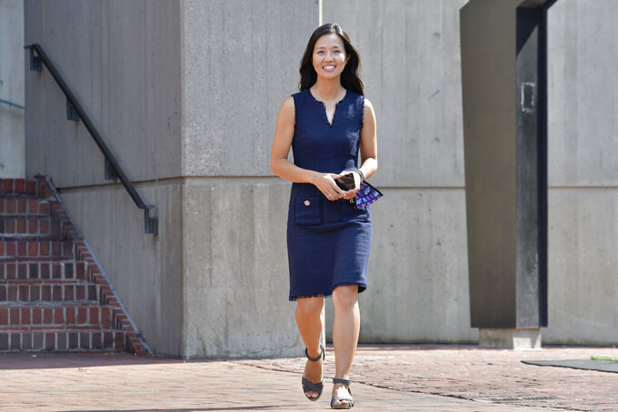 Mayoral Candidate City Councilor Michelle Wu arrives at a news conference outside City Hall in Boston on Wednesday, Sept. 15, 2021. Wu placed first in a preliminary mayoral election that selected two top contenders from a field of five candidates all of whom are people of color, four of them women. (AP Photo/Josh Reynolds)
