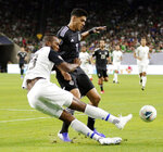 Costa Rica defender Kendall Waston (19) falls as he kicks the ball away from Mexico forward Raul Jimenez during the first half of a CONCACAF Gold Cup soccer quarterfinal Saturday, June 29, 2019, in Houston. (AP Photo/Michael Wyke)