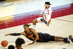 Oklahoma State guard Rondel Walker (5) fights for a loose ball with Iowa State guard Tyler Harris during the second half of an NCAA college basketball game, Monday, Jan. 25, 2021, in Ames, Iowa. Oklahoma State won 81-60. (AP Photo/Charlie Neibergall)
