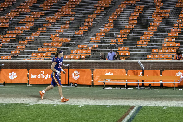 Clemson quarterback Trevor Lawrence (16) runs off the field after the team's win over Pittsburgh in an NCAA college football game Saturday, Nov28, 2020, in Clemson, S.C. (Ken Ruinard/The Independent-Mail via AP, Pool)