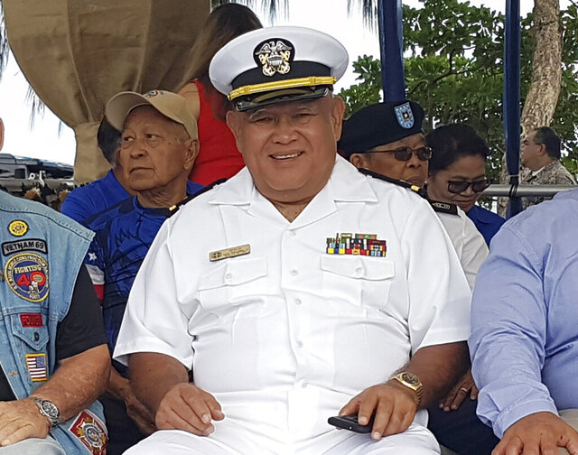 In this 2019 photo, provided by Amy Sue Borja Santos, is her father, Vicente Borja at a Veteran of the Year ceremony in Ypao Beach, Guam. Vicente Borja is one of six former Hawaii residents who are living in Guam and the U.S. Virgin Islands suing to be able to vote by absentee ballot for president. Their federal lawsuit filed late Thursday, Oct, 8, 2020, says they are being treated like