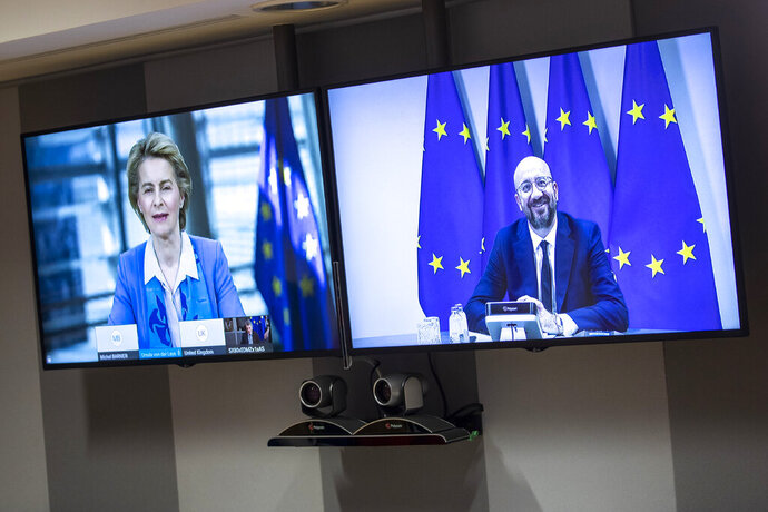 European Council President Charles Michel, on screen right, speaks via videoconference to European Commission President Ursula von der Leyen, screen left, prior to EU-UK talks via videoconference at the European Council building in Brussels on Monday, June 15, 2020. EU Commission President Ursula von der Leyen, European Parliament President David Sassoli and European Council President Charles Michel held a videoconference with British Prime Minister Boris Johnson on Monday to assess the state of negotiations between both sides on a future trade agreement. (AP Photo/Francisco Seco, Pool)
