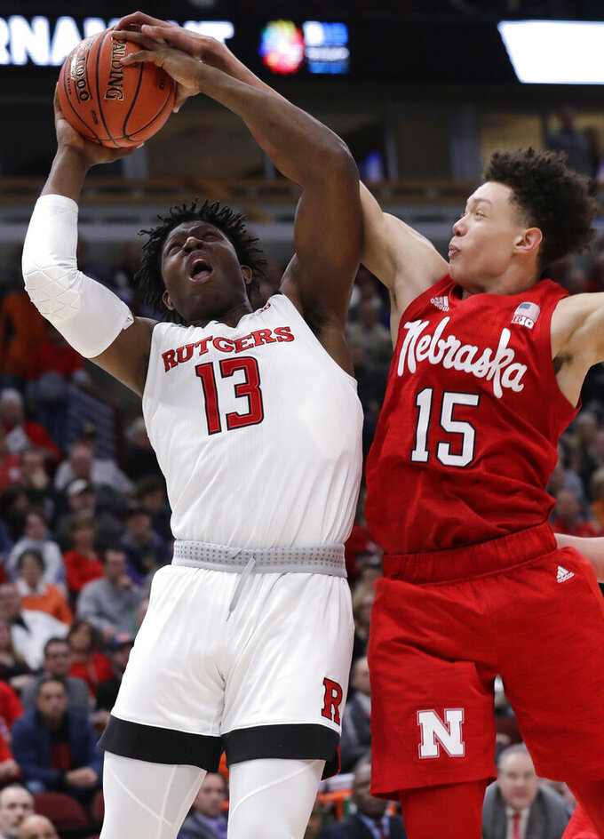 Nebraska forward Isaiah Roby, right, blocks a shot by Rutgers forward Shaq Carter during the second half of an NCAA college basketball game in the first round of the Big Ten Conference tournament in Chicago, Wednesday, March 13, 2019. Nebraska won 68-61. (AP Photo/Nam Y. Huh)