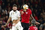 France's Olivier Giroud, left, and Albania's Kastriot Dermaku jump for the ball during the Euro 2020 group H qualifying soccer match between Albania and France at Arena Kombetare stadium in Tirana, Sunday, Nov. 17, 2019. (AP Photo/Hektor Pustina)