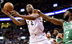 Boston Celtics guard Jaylen Brown (7) fouls Toronto Raptors forward Kawhi Leonard (2) during second half NBA basketball action in Toronto on Tuesday, Feb. 26, 2019. THE CANADIAN PRESS/Frank Gunn/The Canadian Press via AP)