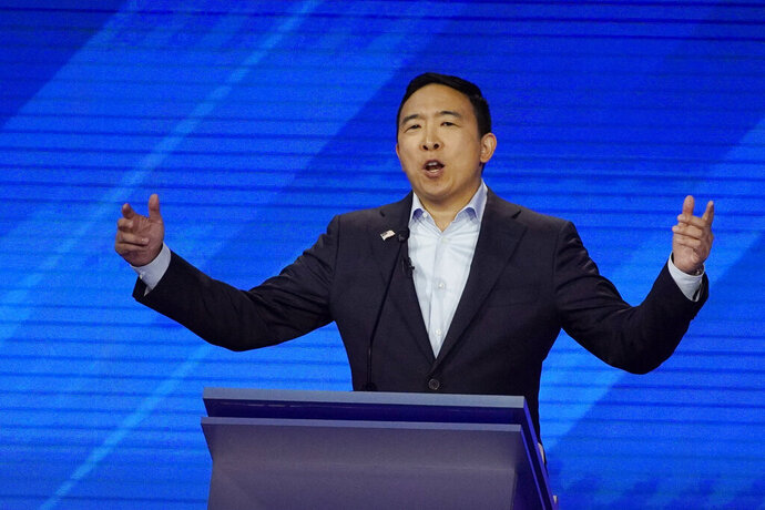 Democratic presidential candidate entrepreneur Andrew Yang speaks Thursday, Sept. 12, 2019, during a Democratic presidential primary debate hosted by ABC at Texas Southern University in Houston. (AP Photo/David J. Phillip)