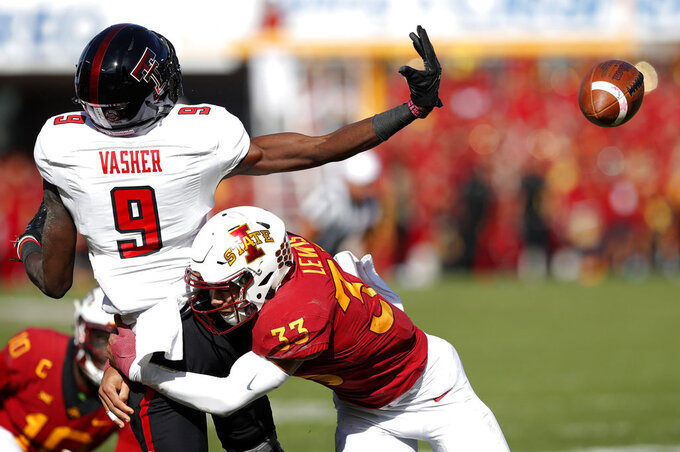 Iowa State defensive back Braxton Lewis (33) breaks up a pass intended for Texas Tech wide receiver T.J. Vasher (9) during the second half of an NCAA college football game, Saturday, Oct. 27, 2018, in Ames, Iowa. (AP Photo/Charlie Neibergall)